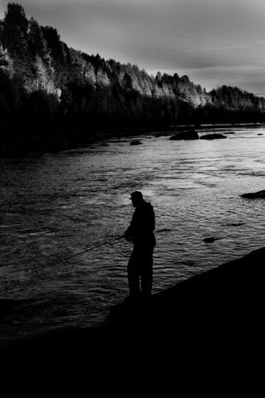 autumn fishing in a river just before sunset photo