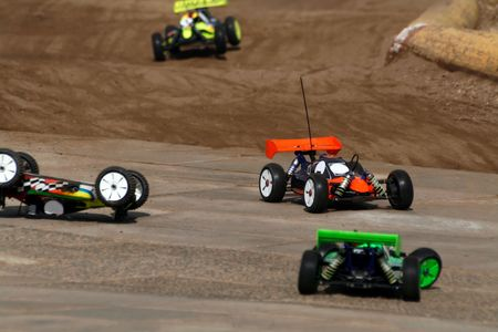 scale model: toy car rally on dirt track