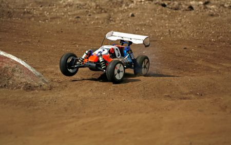 toy car: rc toy car rally on dirt track Stock Photo