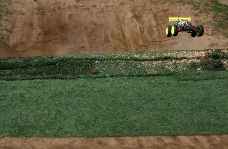 rc toy car rally on dirt track photo