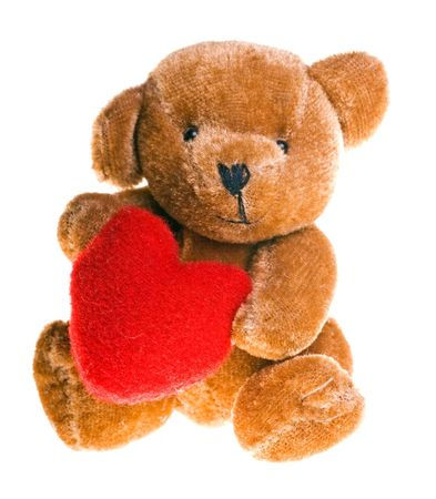 cute little teddy bear holding a heart photo