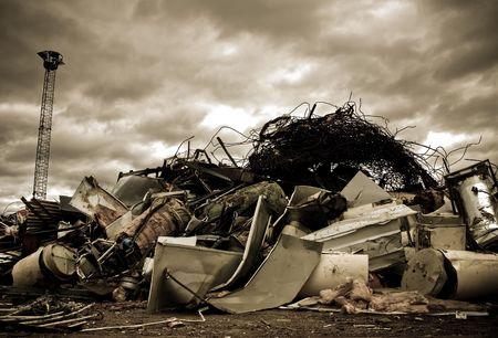 a large pile of metal chinks on a junkyard