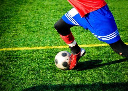 soccer player giving the football a good kick