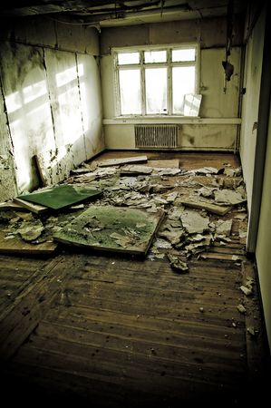 interiors of a neglected house in really bad condition  filled with mold and devastation photo