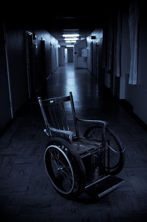 old wheelchair standing in a empty corridor