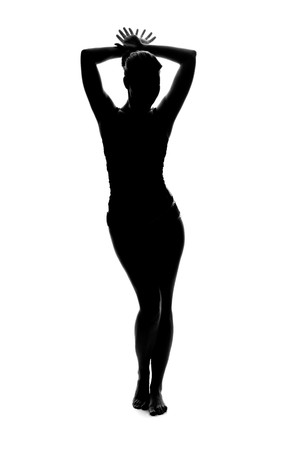 silhouette of a beautiful young woman posing Stock Photo
