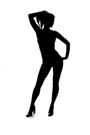 sexy black and white: silhouette of a beautiful young woman posing Stock Photo