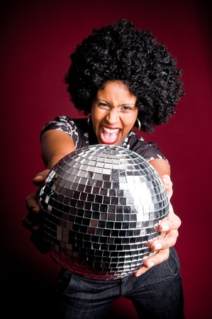 70s disco girl with a disco ball and a big afro hair Stock Photo
