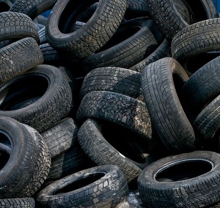 trashed: a large pile of used car tires waiting for recycling Stock Photo
