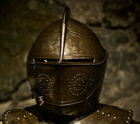 a medieval knight helmet of shining metal photo