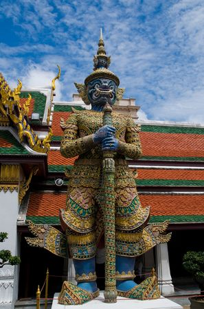 splendour: Guardian statue at the temple Wat phra kaeo in the Grand palace area, one of the major tourism attraction in Bangkok, Thailand