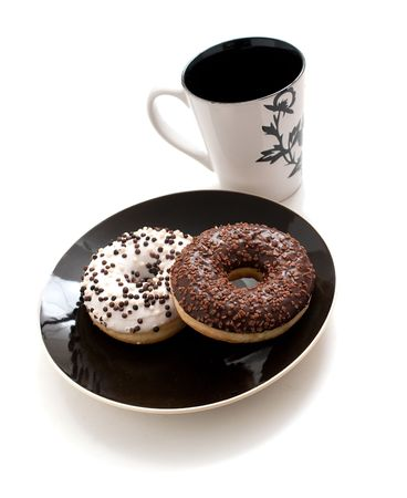 a cup of hot coffe and two tasty doughnuts Stock Photo - 5869252