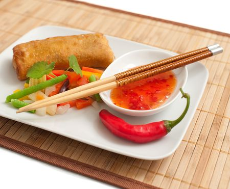 an asian spring roll and fresh vegetables