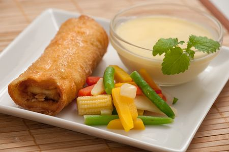 an asian spring roll and some hot thai soup photo
