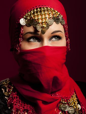 a beautiful woman wearing a red exotic veil photo