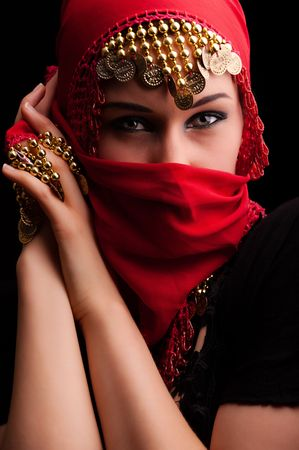 veils: a beautiful woman wearing a red exotic veil