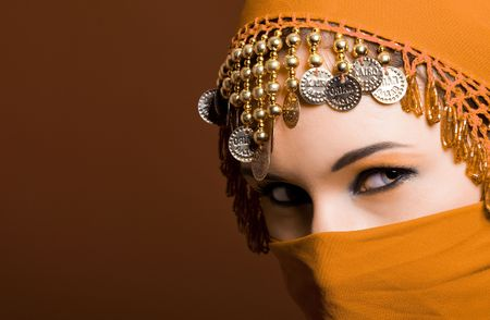 mystery of faith: a beautiful woman wearing a red exotic veil