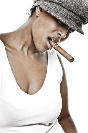 a beautiful girl of african descent with hat and a cigar Stock Photo - 6377069