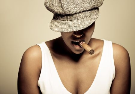 a beautiful girl of african descent with hat and a cigar Stock Photo - 6377097