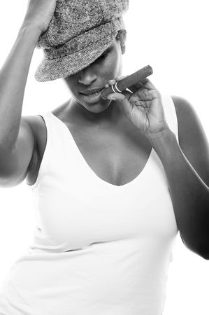 cigar smoking woman: a beautiful girl of african descent with hat and a cigar