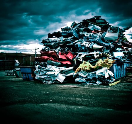 scrap heap: Pile of discarded cars on junkyard