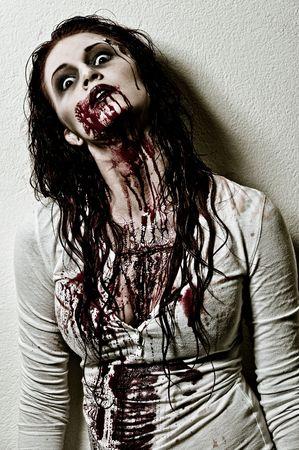a bloody and scary looking zombie girl Zdjęcie Seryjne