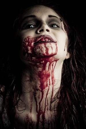 a bloody and scary looking zombie girl Stock Photo