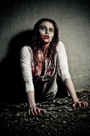 a bloody and scary looking zombie girl Stock Photo - 6959821