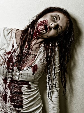 nightmare: a bloody and scary looking zombie girl Stock Photo