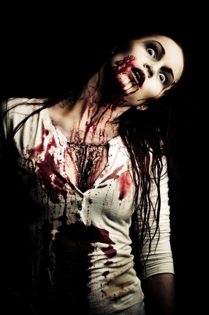 a bloody and scary looking zombie girl Stock Photo - 6959847