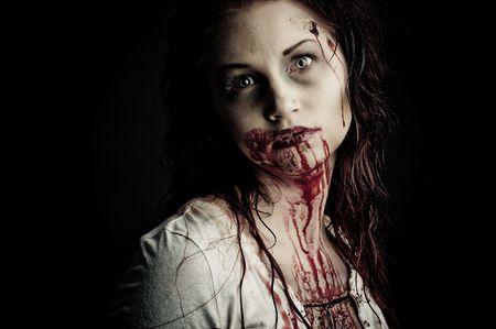 a bloody and scary looking zombie girl photo