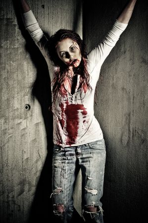a bloody and scary looking zombie girl Stock Photo - 6959852