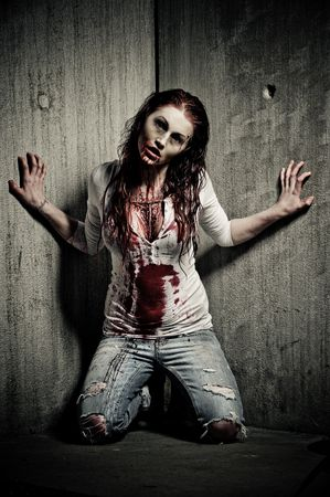 possessed: a bloody and scary looking zombie girl Stock Photo