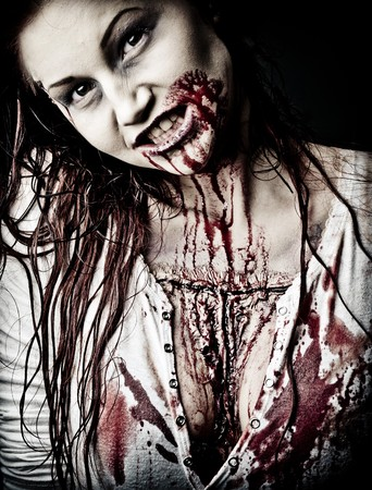 a gory bloody and scary zombie girl Stock Photo