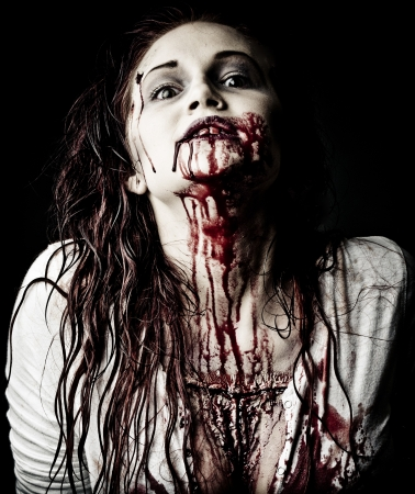 a gory bloody and scary zombie girl photo