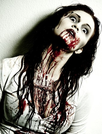 ugly girl: a gory bloody and scary zombie girl Stock Photo