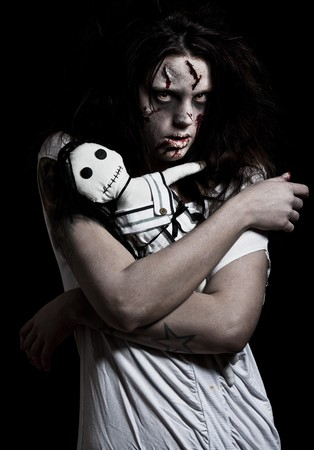 Una chica de aspecto temible poseída por un demonio  Foto de archivo - 7941935
