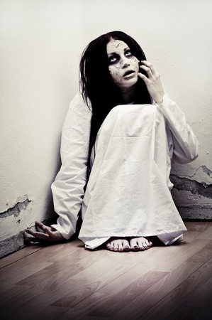 a scary ghost girl wearing a white nightie Stock Photo