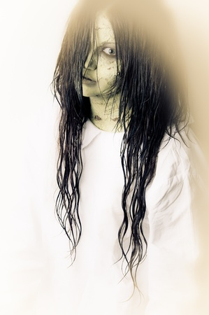 nightie: a scary ghost girl wearing a white nightie Stock Photo