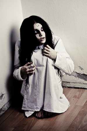 ghosts: a scary ghost girl wearing a white nightie Stock Photo