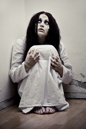 a scary ghost girl wearing a white nightie photo