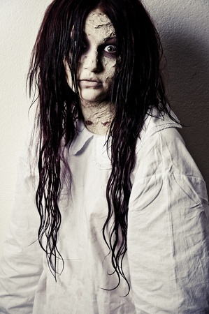 a scary ghost girl wearing a white nightie Stock Photo - 8462654