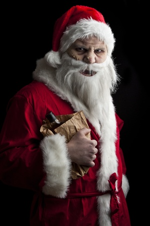 a drunk santa with a liquer bottle in a brown paper bag photo