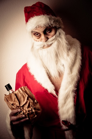 a drunk santa with a liquer bottle in a brown paper bag Stock Photo - 8462648