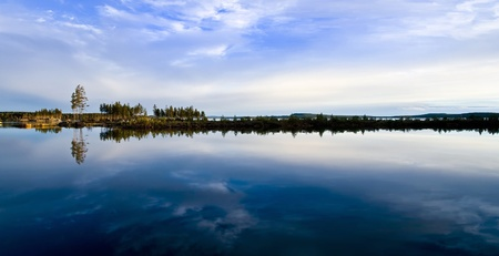 A dramatic sky reflecting in a calm northern lake photo