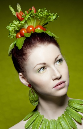 a colorful and creative makeup shot with fresh vegetables