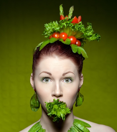 a colorful and creative makeup shot with fresh vegetables photo