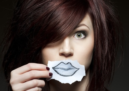 a young beauty with a drawn paper mouth Stock Photo - 9010565