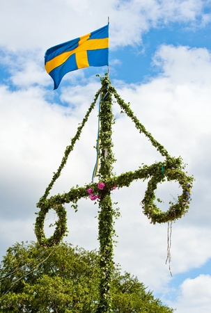 a traditional swedish midsummer pole with a swedish flag Stock Photo - 9986049