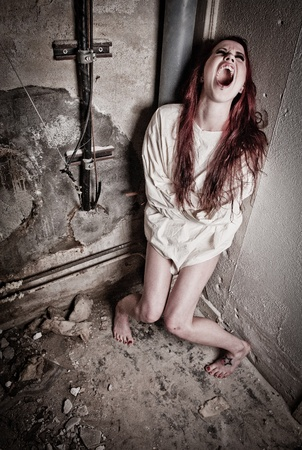 straight jacket: an insane psycho girl wearing a straight jacket